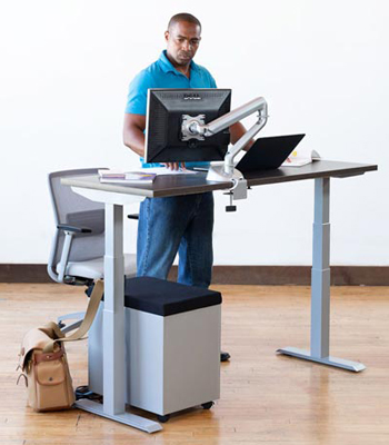 man standing at standing desk